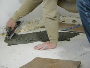 Laying ceramic tiles on the floor