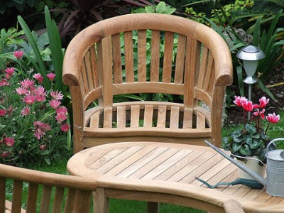Patio furniture made of wood with their hands