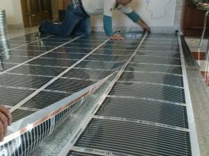 laying electric warm floor